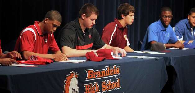 SPORTS   Athletes sign papers during college signing day for athletes at Brandeis High School on February 1, 2012 Tom Reel/ San Antonio Express-News Photo: TOM REEL, SAN ANTONIO EXPRESS-NEWS / © 2012 San Antonio Express-News  MAGS OUT; TV OUT; NO SALES; SAN ANTONIO OUT; AP MEMBERS ONLY; MANDATORY CREDIT; EFE OUT