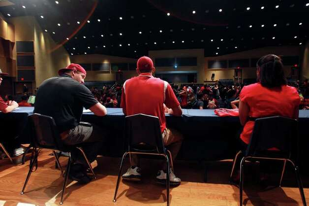 SPORTS   Athletes face the student body on stage during college signing day for athletes at Brandeis High School on February 1, 2012.  From left are Kyle Marrs, Colin Blake and Lauren Blakes.  Tom Reel/ San Antonio Express-News Photo: TOM REEL, SAN ANTONIO EXPRESS-NEWS / © 2012 San Antonio Express-News  MAGS OUT; TV OUT; NO SALES; SAN ANTONIO OUT; AP MEMBERS ONLY; MANDATORY CREDIT; EFE OUT