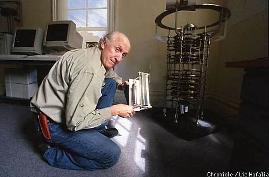 Stewart Brand demonstrated a model of his solar-synchronized mechanical clock. The end product could be as large as  Stonehenge. Chronicle Photo by Liz Hafalia