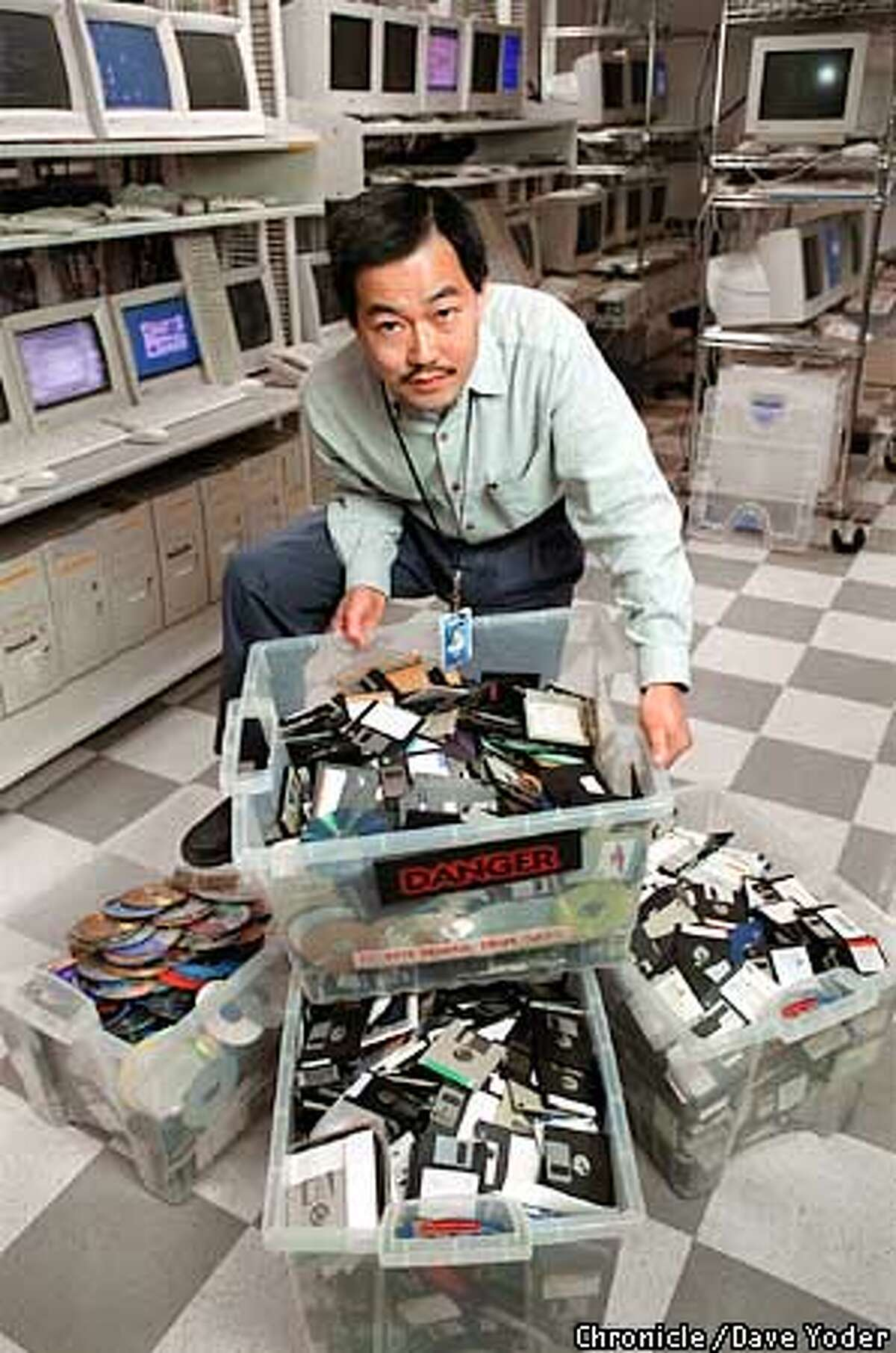 Senior Director of Engineering Harry Wan displays tubs full of condemned software to be destroyed. No software media are allowed to leave the room to make sure computer viruses do not escape Symantec's Anti-Virus Research Center in Santa Monica, California. Photograph by Dave Yoder/for the Chronicle