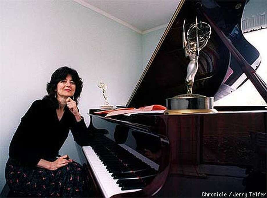 Rita Abrams at home with her Emmys. Chronicle Photo by Jerry Telfer