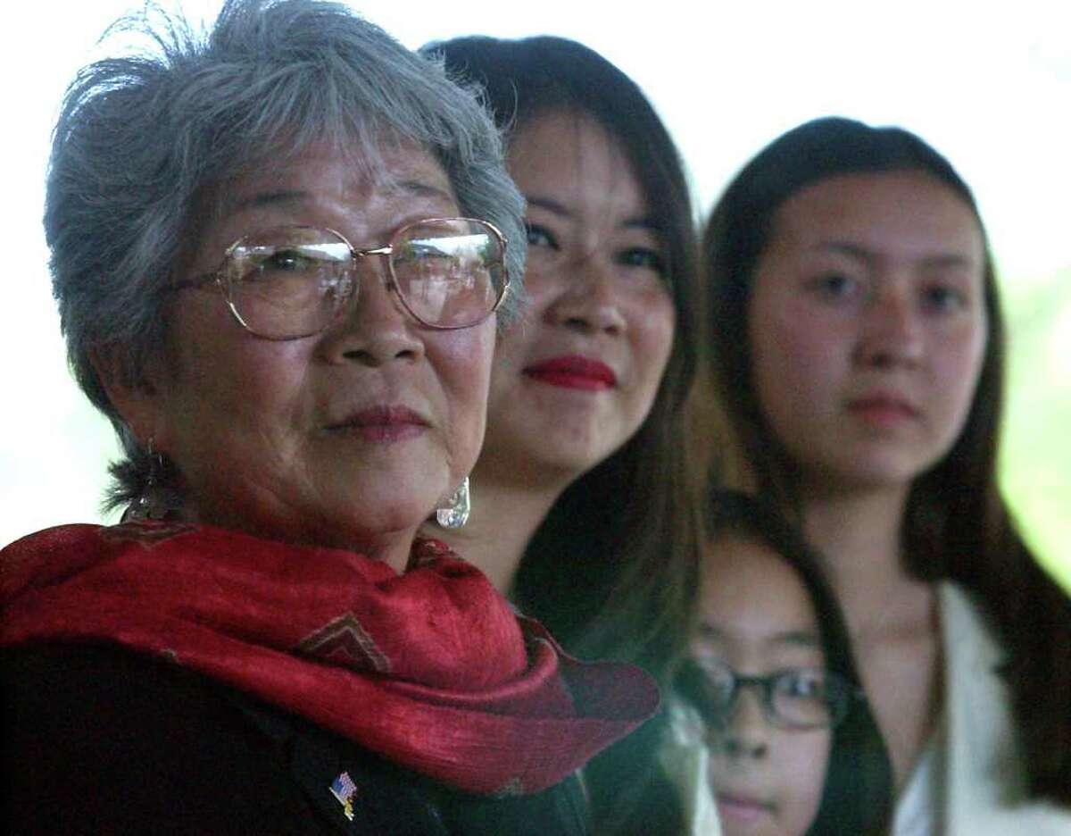 METRO - Mabel Jingu Enkoji (left) along with her daughter, Peggy Nishio, her grand-daughters Stefanie Nishio and Miyoshi Busch listen to guest speakers during a ceremony held in their honor at the Japanese Tea Gardens on Thursday, April 4, 2002. Jingu Enkoji was the daughter of Kimi Eizo Jingu, one of the builders of the Japanese Tea Gardens. She lived with her family at the garden prior to their eviction during WWII. She and her family were honorably and warmly welcomed home for her families achievment in building one the popular tourist spots in the city. (Kin Man Hui/staff)