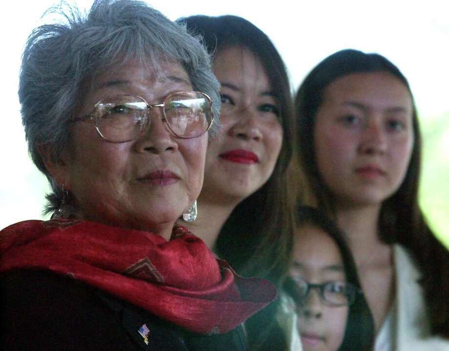 METRO - Mabel Jingu Enkoji (left) along with her daughter, Peggy Nishio, her grand-daughters Stefanie Nishio and Miyoshi Busch listen to guest speakers during a ceremony held in their honor at the Japanese Tea Gardens on Thursday, April 4, 2002. Jingu Enkoji was the daughter of Kimi Eizo Jingu, one of the builders of the Japanese Tea Gardens. She lived with her family at the garden prior to their eviction during WWII. She and her family were honorably and warmly welcomed home for her families achievment in building one the popular tourist spots in the city. (Kin Man Hui/staff) Photo: KIN MAN HUI, SAN ANTONIO EXPRESS-NEWS