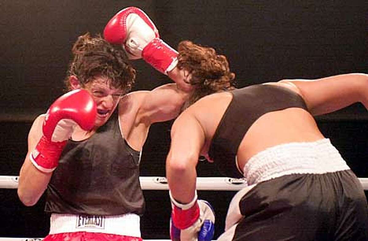 Fights on the waterfront at Pier 32. Susan Howard (red gloves), 37 of Novato beats Bambi Bertoncello, (blue gloves),21, of Seattle. Photo by John Storey.