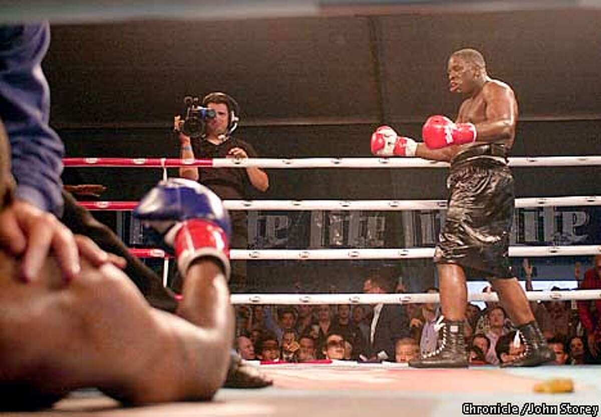 Fights on the waterfront at Pier 32. Terrence Lewis (red gloves) of Philly knocks out Robert Davis of Akron, Ohio. Photo by John Storey.