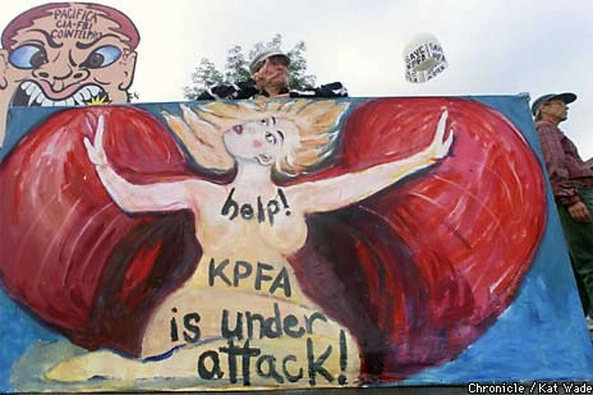 Berkeley resident and KPFA supporter, artist Annie Hallatt, did a protest painting and stood amongst hundreds of protesters in front of KPFA radio station. Chronicle Photo by Kat Wade