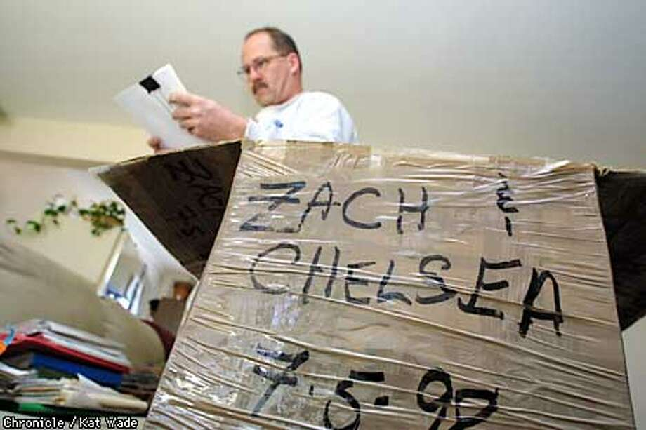 "Memoribilia and court records fill a box marked with the names of Michael S. Smith's two children, Zachary and Chelsea, now 12 and 9, who were allegedly abducted by their mother when they were 9 and 6. Federal authorities believe that they disappeared with the help of ""The Children of the Underground"" a covert vigilante group that supposedly helps women and children escape from abusive relationships. SAN FRANCISCO CHRONICLE PHOTO BY KAT WADE Photo: KAT WADE"