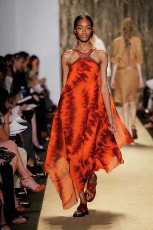 Michael Kors' spring collection incorporated orange into a safari theme. Kohl's will sell Dana Buchman's zebra poncho, $52, in March. Photo: Michael Kors