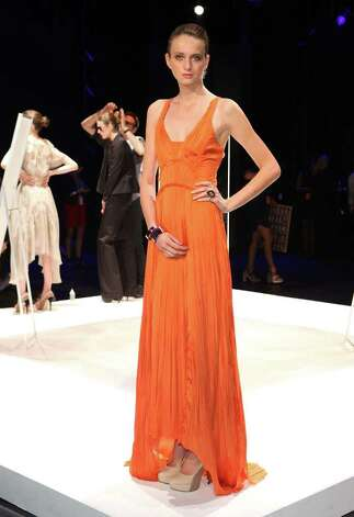 Bibhu Mohapatra's bright tangerine dress and Banana Republic's honeysuckle version are on trend. Photo: Dario Cantatore, Stringer / 2011 Getty Images