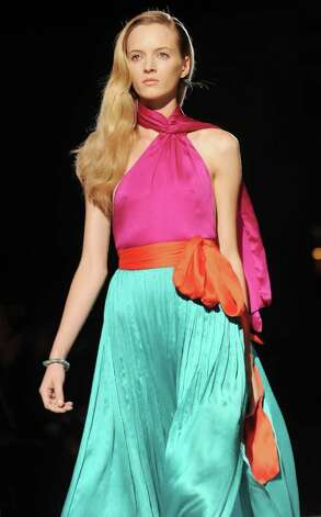 Bright colors, particularly pink, are a highlight of spring looks that JC Penney interpreted from the runways. The color-block trend originated with designers such as Salvatore Ferragamo, whose models sported the look for spring/summer lines. Photo: Stefania D'Alessandro, Stringer / 2011 Getty Images