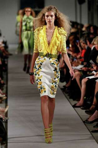 The plunging neckline of an  Oscar De La Renta floral-print look gets taken up on a Banana Republic dress. Photo: Peter Michael Dills, Stringer / 2011 Getty Images
