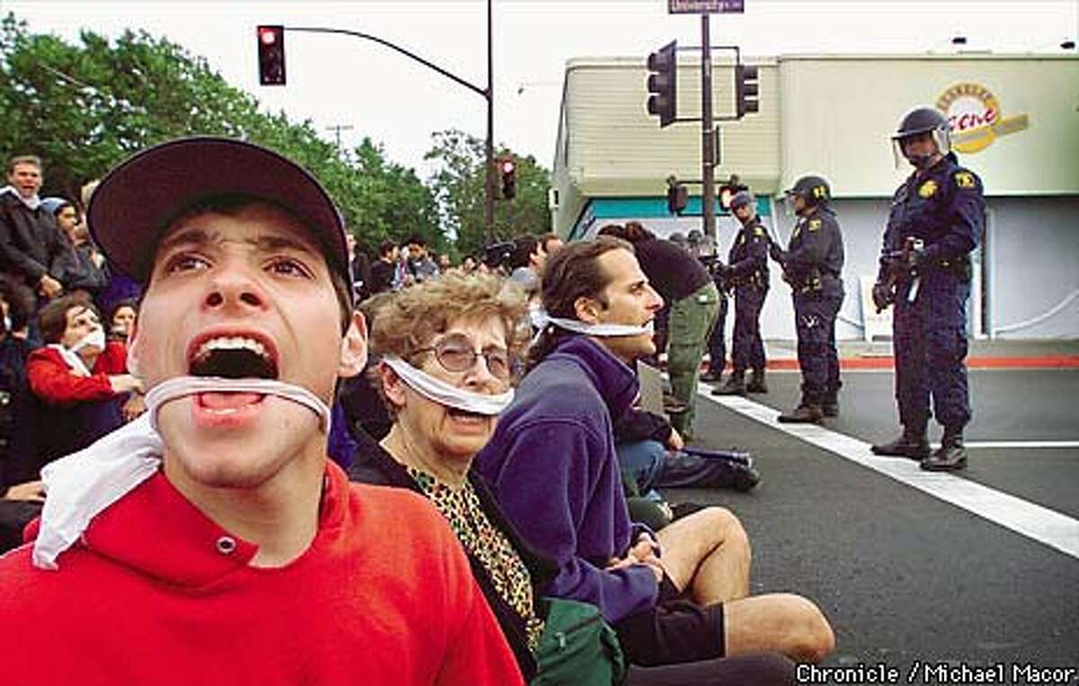 At the corner of University Avenue and Sixth Street, KPFA supporters wore gags to express opposition to Pacifica's gag orders. Chronicle Photo by Michael Macor