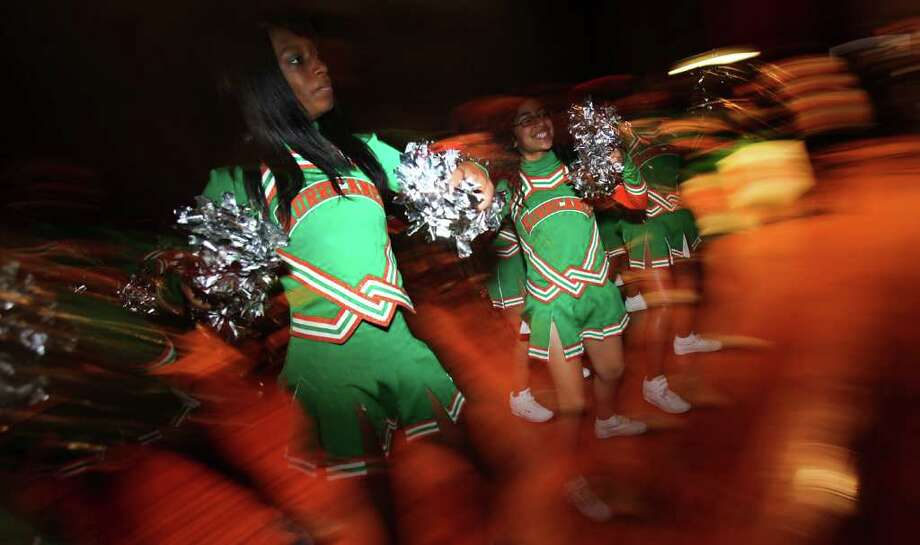 Sam Houston High School cheerleaders lead the school in a cheer as seven football players from Sam Houston High School committed to college teams on National Signing Day. Wednesday, Feb. 1, 2012. Bob Owen/Express-News Photo: BOB OWEN, San Antonio Express-News / © 2012 San Antonio Express-News