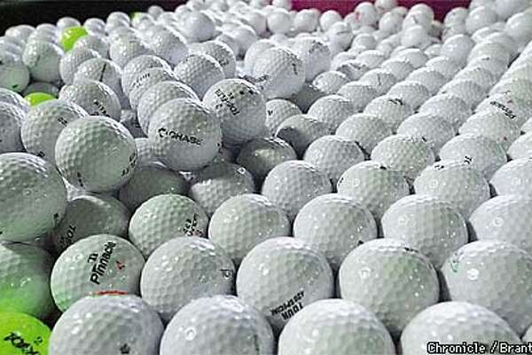 NBGOLF3-06JUL99-NF-BW--At the Santa Rosa Golf Center, hundreds of golf balls sit idle. The driving range was shut down because of concerns about the environment, the sight of huge poles and an occasional ball on the freeway nearby. By Brant Ward/Chronicle