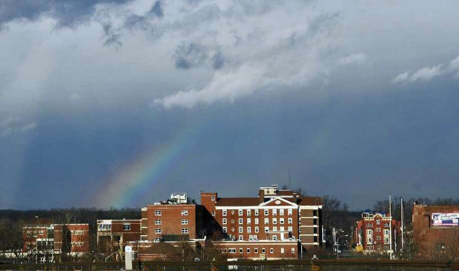 A rainbow is visible in the distance beyond Schenectady County Community College on Wednesday Feb. 1, 2012 in Schenectady, NY.  (Philip Kamrass / Times Union ) Photo: Philip Kamrass