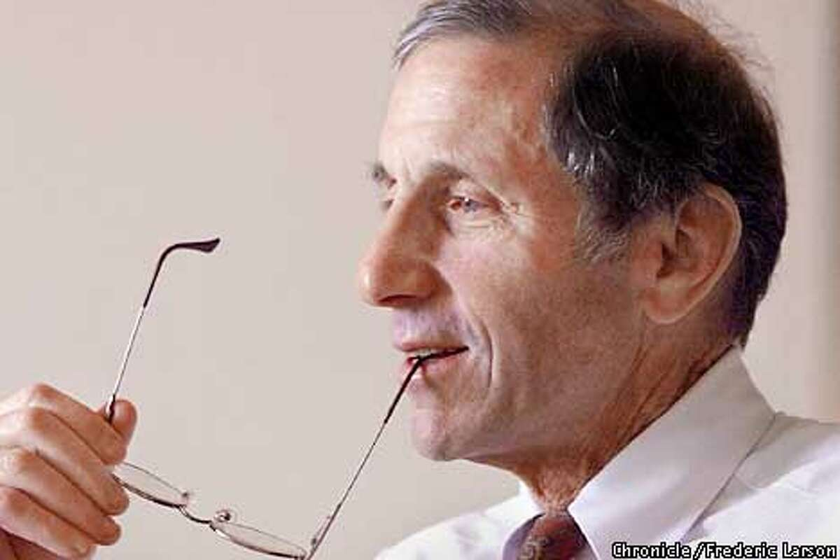 : A profile of SF financier Warren Hellman during a meeting at Hellman & Friedman, One Maritime Plaza, SF. Chronicle photo by Frederic Larson