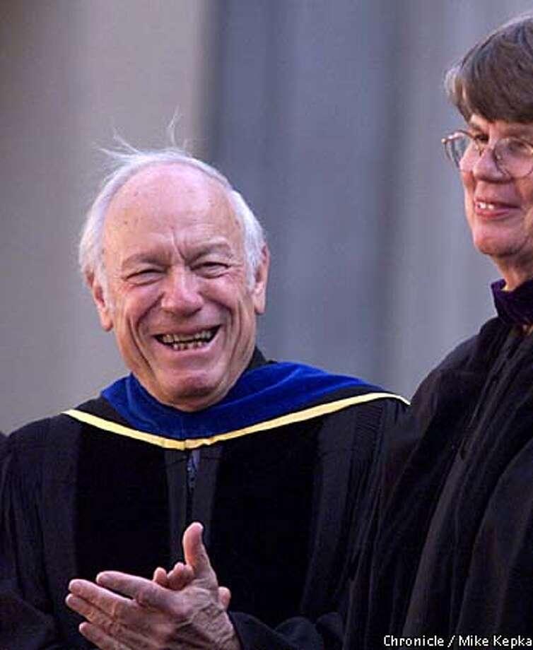 Professor Leon Litwack applauded after Janet Reno spoke at last week's UC Berkeley commencement. Chronicle photo by Mike Kepka