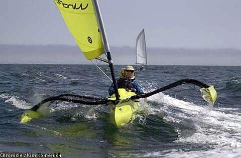 A tussle between man, trimaran and sea / Humpbacks, big swells