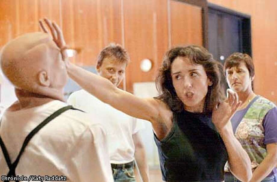 DEFENSEc-C-03MAY01-LV-RAD  Photo by Katy Raddatz--The Chronicle  Cordelia Clancy teaching a self defense class at Foothill College in Los Altos Hills. Cordelia shown how to flatten an attacker's nose on the bad guy rubber dummy while Kjell Karlsson and Linda Watkins observe closely. Photo: KATY RADDATZ