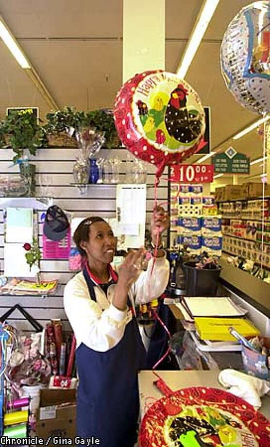 Sonia Jackson finished work on a Mother's Day balloon at a Hayward Safeway store. Chronicle photo by Gina Gayle