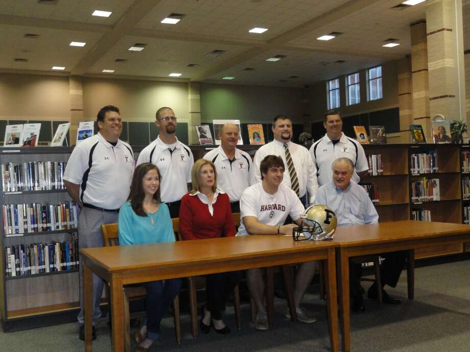 Foster High defensive lineman Doug Webb has signed with Harvard University.Pictured are Natalie Webb  (sister), Cindy Webb (mother), Doug Webb, and Paul Webb  (father);and coaches Scott Lionberger, Keith  Williams, Mark Wiatrek, Jeff Rayome and Michael  Harvey.   Photo: Handout Photo