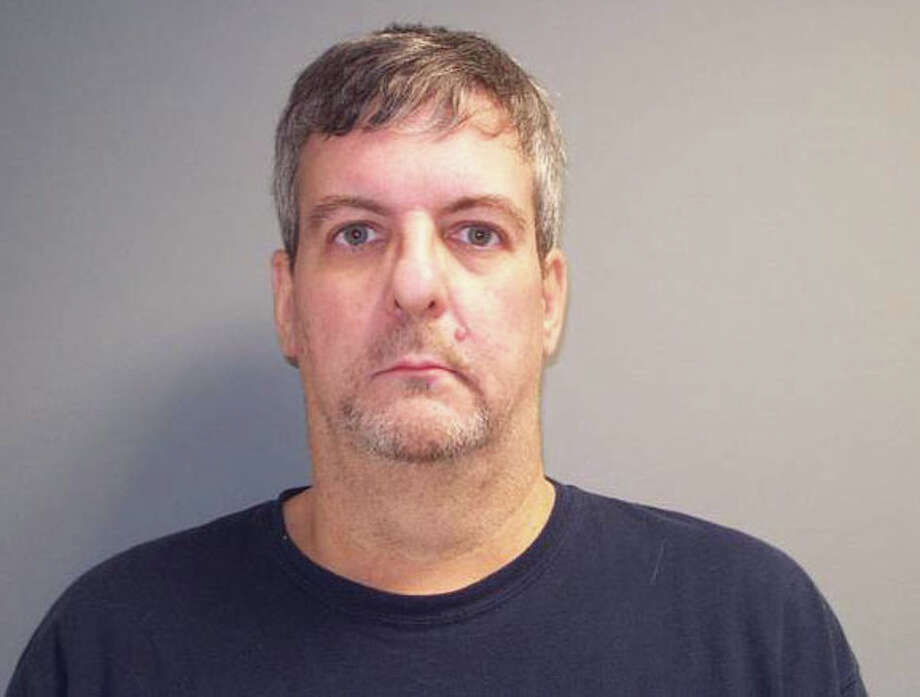 Jeffrey Grim, 49, of 18 Cat Rock Road, Cos Cob, was charged with possession of narcotics, possession of narcotics with intent to sell, illegal possession of narcotics within 1,500 feet of a school, possession of narcotics with intent to sell within 1,500 feet of a school and possession of drug paraphernalia within 1,500 feet of a school and conspiracy to commit the above offenses after being pulled over Tuesday, Jan. 31, 2012 in Norwalk, Conn. Photo: Contributed Photo