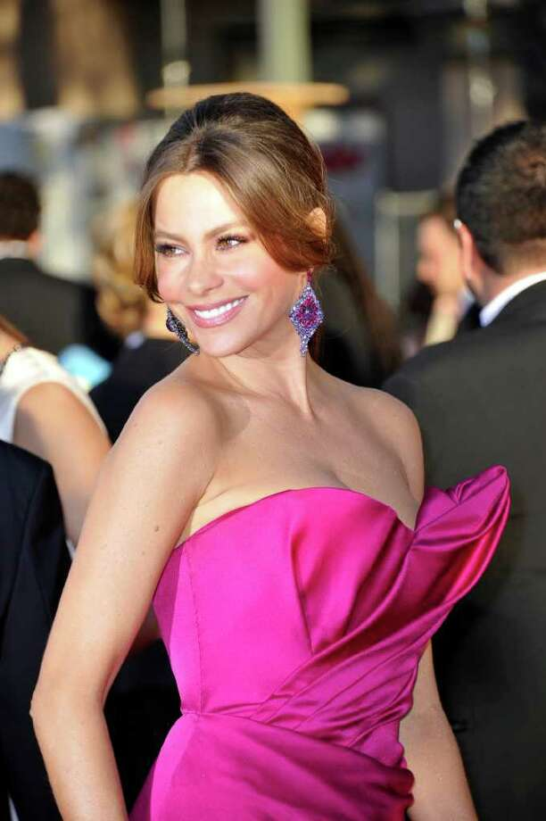 Actress Sofia Vergara arrives to the 18th Annual Screen Actors Guild Awards at the Shrine Auditorium in Los Angeles, California on January 29, 2012. AFP PHOTO / JOE KLAMAR Photo: JOE KLAMAR, AFP/Getty Images / 2012 AFP