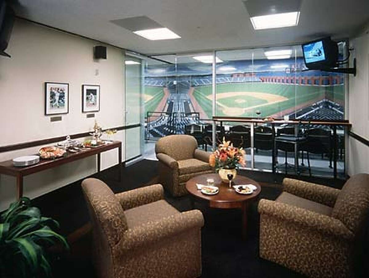 The Giants built a mock suite, top, to show individuals who are interested in leasing a box. Photo by David Wakely, San Francisco Giants