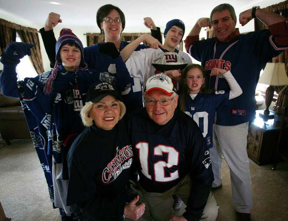 Patriots fans Bill and Louise Brady of Weston are outnumbered their family of Giants fans. Back row from left are Maxwell Tavitian, 11, Darleen Tavitian, Zachary Tavitian, 13, Grace Tavitian, 7, and John Tavitian, all of Milford. Photo: Brian A. Pounds / Connecticut Post