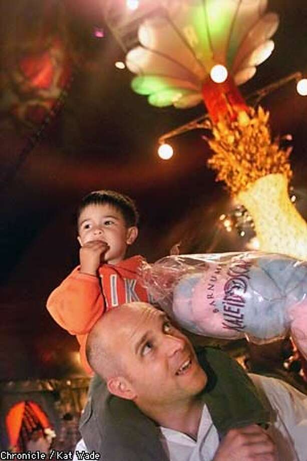 Rich Prahn gave his 2-year-old son, Evan, a ride on his shoulders during the intermission of Barnum's Kaleidoscape. Chronicle Photo by Kat Wade