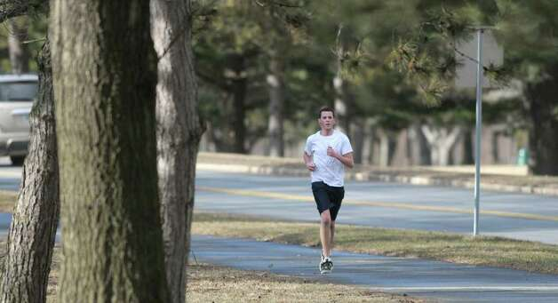 UAlbany junior Chris Towler from Port Jefferson, Long Island goes for a run around campus on Wednesday, Feb. 1, 2012 in Albany, N.Y.  (Paul Buckowski / Times Union) Photo: Paul Buckowski