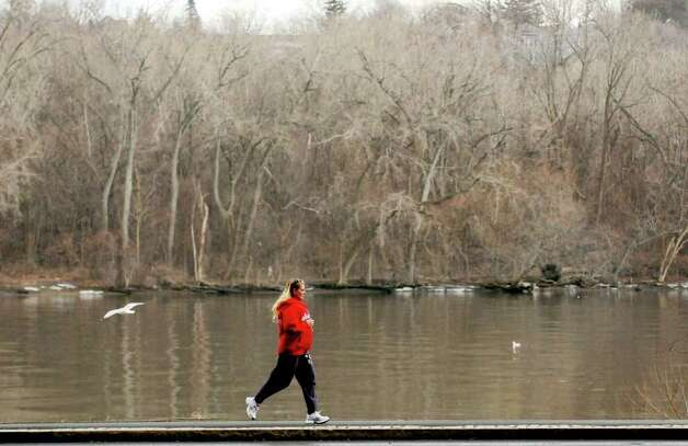 A women takes a midday run along the Hudson River at the Corning Preserve in Albany, New York Wednesday Feb.1, 2012.( Michael P. Farrell/Times Union) Photo: Michael P. Farrell