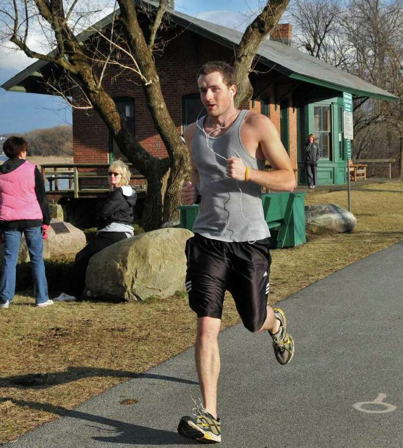 "Greg Donohue of Niskayuna gets in a run along the bike path in Niskayuna as temps hit the upper 50s Wednesday Feb. 1, 2012.  ""You won't see many days like this in February"" says Donohue.  (John Carl D'Annibale / Times Union) Photo: John Carl D'Annibale / 00016302A"
