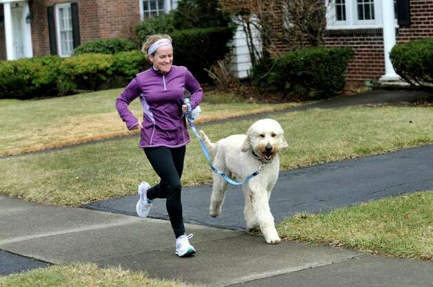 City resident Margaret Bromirsky goes on her daily run with Harley on a springlike day on Wednesday, Feb. 1, 2012, in Albany, N.Y. (Cindy Schultz / Times Union) Photo: Cindy Schultz / 00016302A