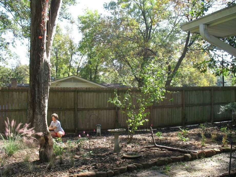"CORRECTS NAME FROM JUDY TO JULIE - In this 2008 image provided by Cliff Shackelford, Julie Shackelford works in her yard in Nacogdoches, Texas. The Texas Parks and Wildlife Department is featuring a ""Drought Survival Kit"" on its website that offers tips on how to landscape using less water. Photo: AP"
