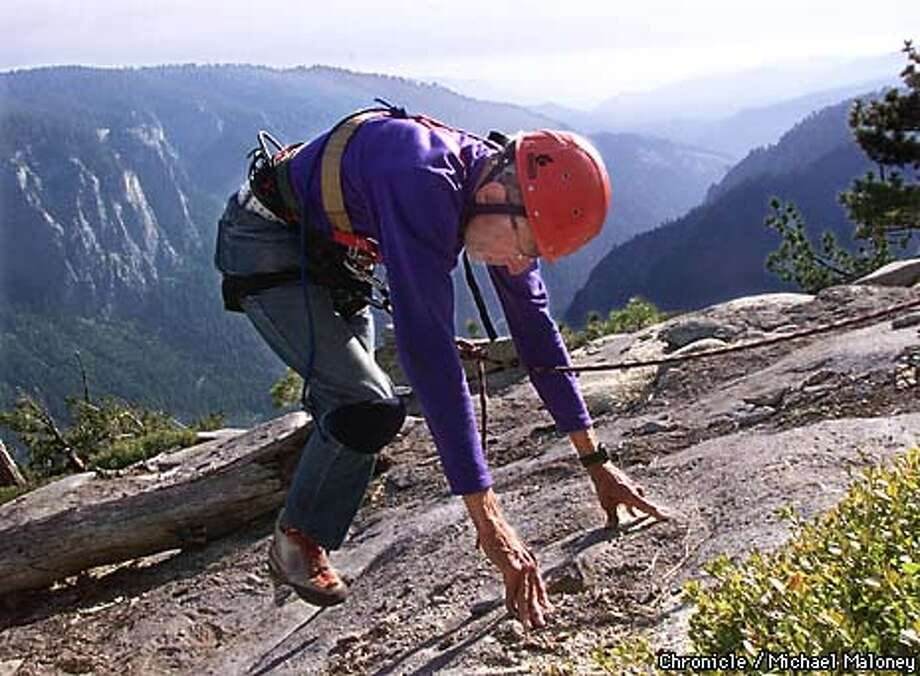 Taking painfully slow steps, 81 year old Gerry Bloch tops out at the top of El Capitan on Sunday, 10 days after starting the climb. The trio started out on the climb last Thursday, May 13th. Bloch broke his own record of being the oldest to scale the 7569 foot granite rock.  CHRONICLE PHOTO BY MICHAEL MALONEY Photo: MICHAEL MALONEY