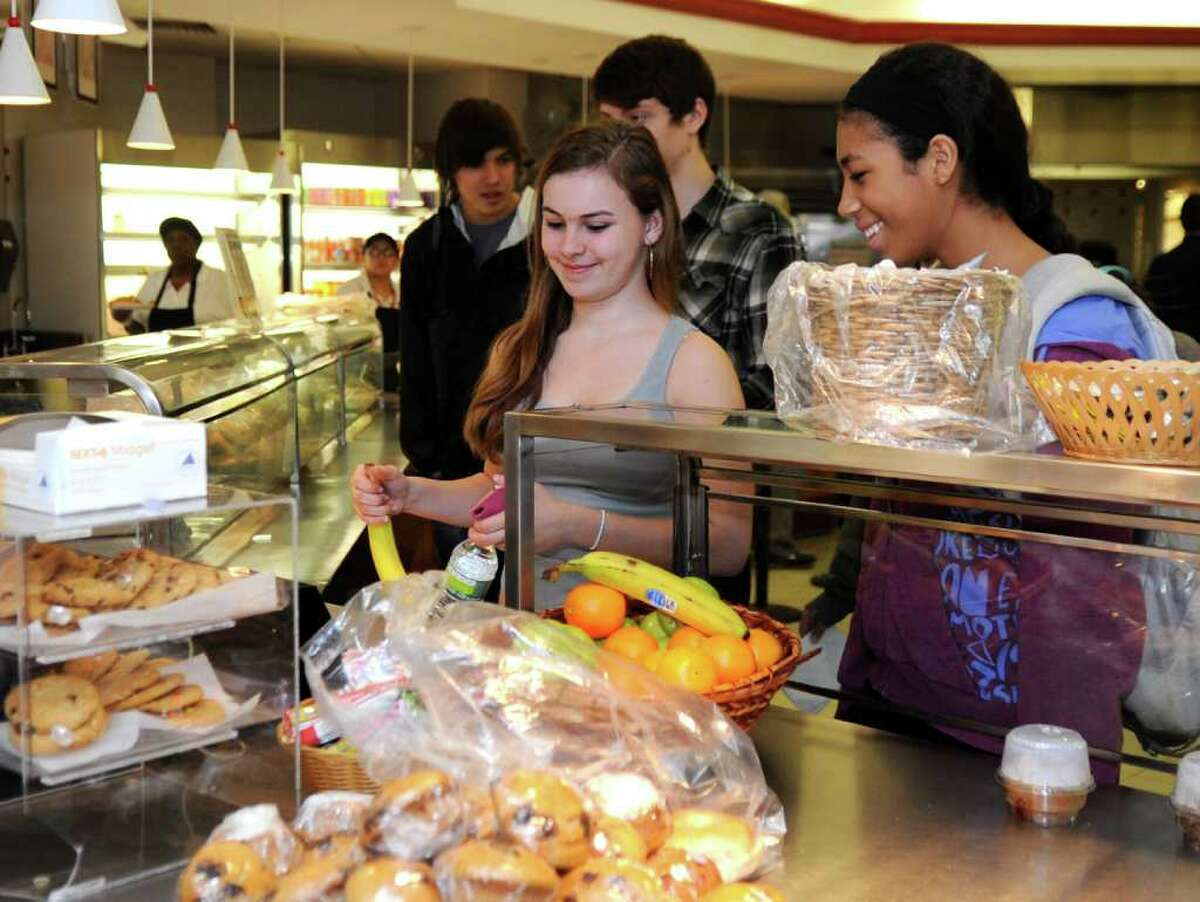 Jenny Ribeiro, 15, buys a banana at the cafeteria at Greenwich High School Wednesday, Feb. 1, 2012. The PTA Council's wellness committee is lobbying the district to provide healthier food to students.