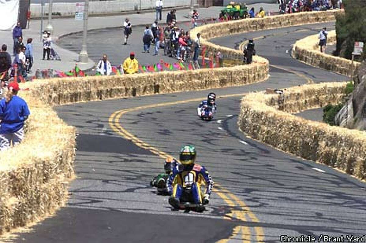 Street lugers got used to the steep hay-lined course past the Cliff House as it goes into the Great Highway Friday. Finals for the events are Saturday and Sunday. Chronicle Photo by Brant Ward