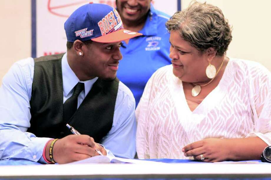 Dekaney High School football player Armand Nance, 17, looks at his mother as he signed his letter of intent to play football at Boise State University during National Signing Day at Dekaney High School Wednesday, Feb. 1, 2012, in Spring. Photo: Johnny Hanson, Houston Chronicle / © 2012  Houston Chronicle