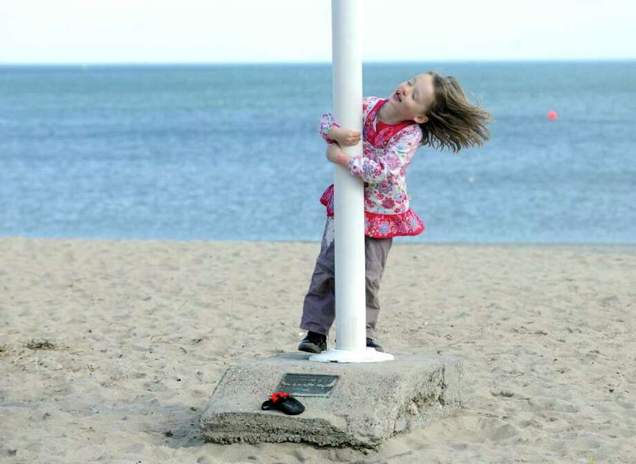Jane Edwards, 4, of Riverside, enjoys the warm winter afternoon at Greenwich Point Wednesday, Feb. 2012. Photo: Helen Neafsey / Greenwich Time
