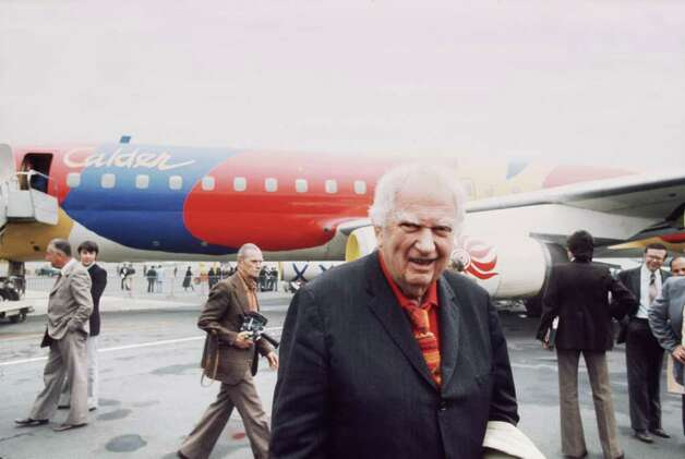 Braniff International Airways was an iconic U.S. airline for more than half a century. Competition following deregulation, along with high fuel prices, drove up its debt to unsustainable levels, and the airline declared bankruptcy in 1982. This is a shot of artist Alexander Calder posing in front of the Braniff jetliner that he painted in 1975. Photo: AFP, AFP/Getty Images / AFP