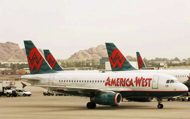 America West took over US Airways in 2005, but ditched its own name, because US Airways was more recognized. Photo: MANDEL NGAN, AFP/Getty Images / 2005 AFP