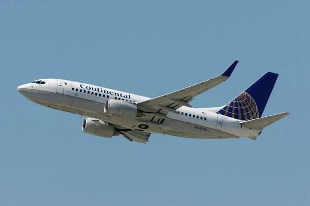 Continental and United airlines are still in the process of merging operations. While Continental's management took control of the new company, and its globe remains on the tail of the combined airline, the United name is the one that survived. Photo: David McNew, Getty Images / 2008 Getty Images