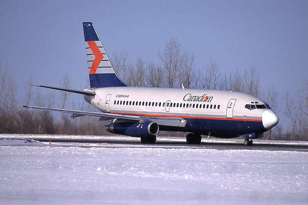 North of the border, Canadian Airlines merged into Air Canada in 2000. Here's a Canadian Boeing 737 at Ottawa Macdonald-Cartier International Airport. photo source Photo: John Davies