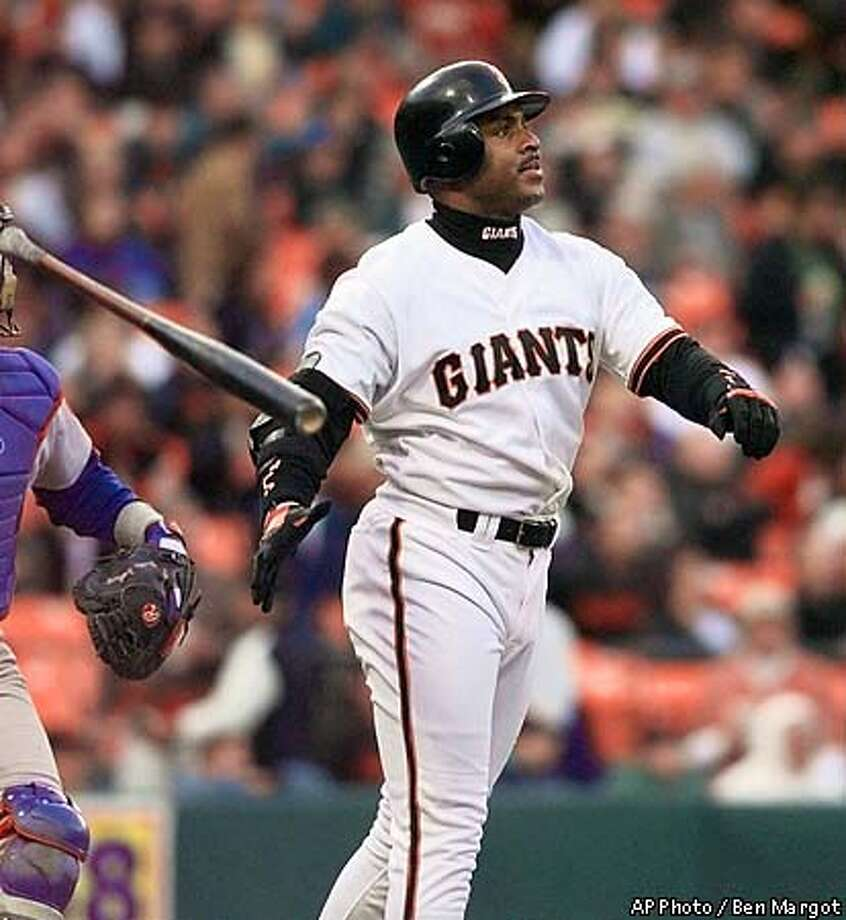 San Francisco Giants' Barry Bonds throws his bat after hitting a two-run homer off Chicago Cubs' Kevin Tapani in the first inning Friday, June 18, 1999, in San Francisco. This was Bonds' first home run since his return from surgery on his left arm. (AP Photo/Ben Margot) Photo: BEN MARGOT