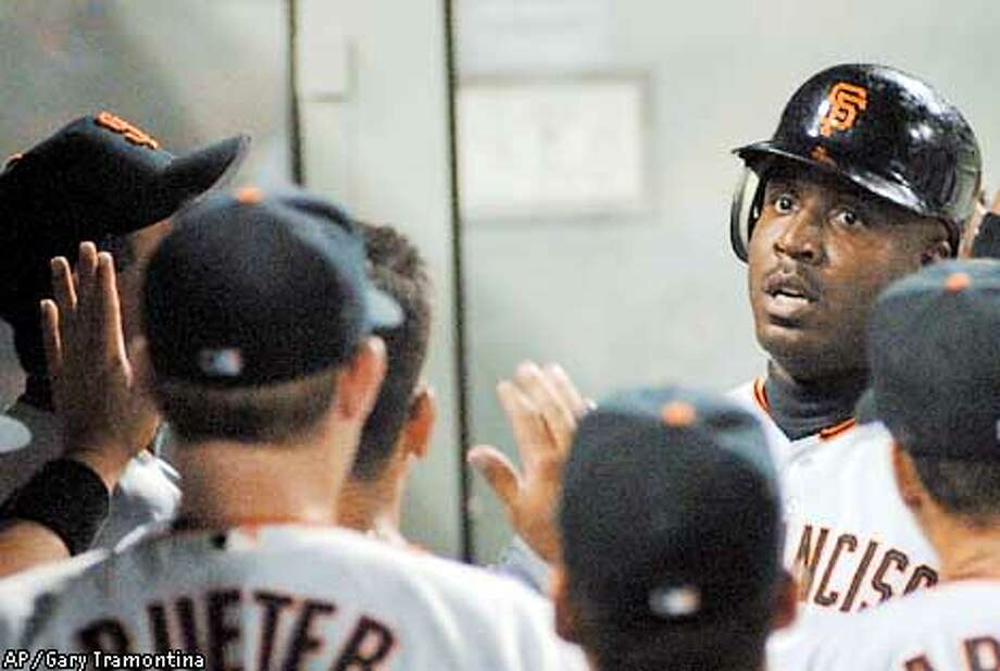 San Francisco Giants' Barry Bonds, right, is congratulated by teammates after hitting a fifth-inning home run against the Pittsburgh Pirates, Wednesday, May 2, 2001, in Pittsburgh. The Giants won 7-6. (AP Photo/Gary Tramontina) Photo: GARY TRAMONTINA