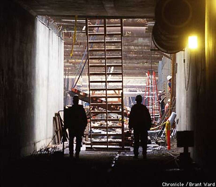 Workers were building huge concrete tunnels north of what will be the station. Chronicle Photo by Brant Ward