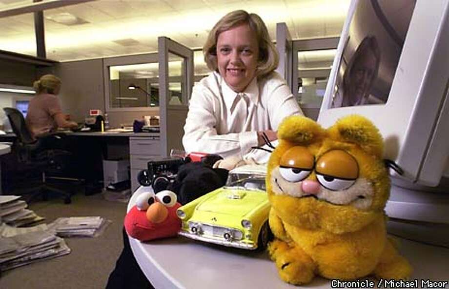 """Meg Whitman CEO of the internet auction site """"Ebay"""" in San Jose. Whitman in the company's work area with a few of the items that can be found at the auction site, from stuffed toys to model cars. by Michael Macor/The Chronicle Photo: MICHAEL MACOR"""