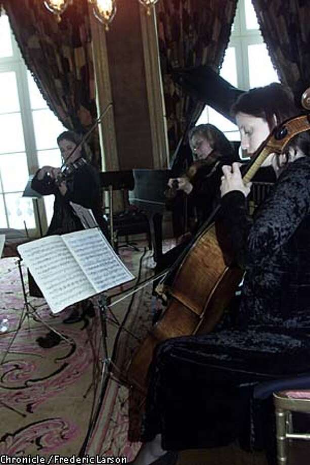 Heather Haughn, Jennifer Hoff-Collins and Melissa M. Morgan of the Bella Cosi string quartet took a master class from violinist Isaac Stern at Gordon and Ann Getty's house in San Francisco. Chronicle photo by Frederic Larson