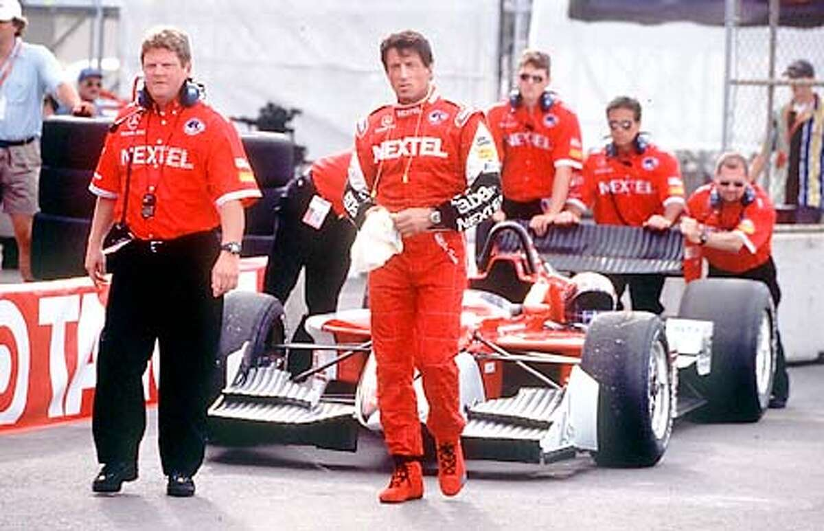 Sylvester Stallone, center, plays an over-the-hill race-car driver in